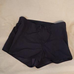 Swim shorts with sewn in bikini bottoms.